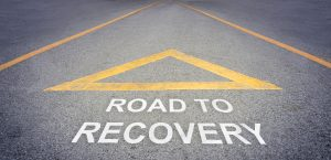 Road To Recovery road sign