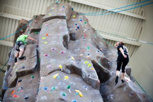 Students rock climb at the Recreation and Wellness Center